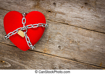 Heart with chains on wooden background - Love lockdown :...