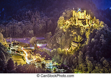 Hohenschwangau Castle at night in the Bavarian Alps of...