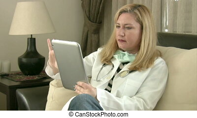 Female doctor using digital tablet pc