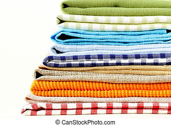 stack of colorful kitchen napkins on white background