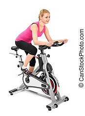 young woman doing indoor biking exercise on spinner