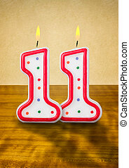 Burning birthday candles number 11