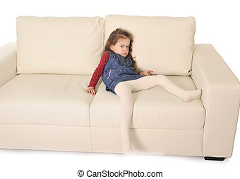 little girl  lying on couch