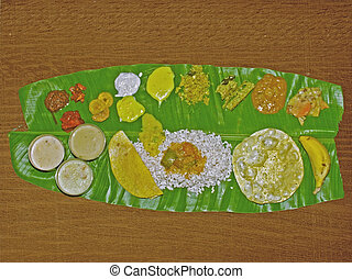 South Indian Thali (meals) served traditionally on banana...