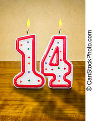 Burning birthday candles number 14