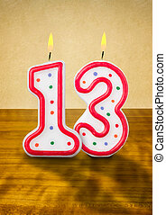 Burning birthday candles number 13