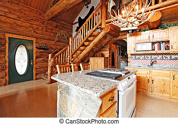 Log cabin house kitchen room with rocky cabinet and white stove. View of entrance hall and rustic stairs