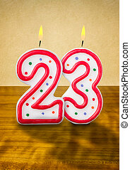 Burning birthday candles number 23