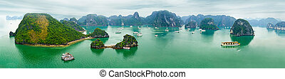 Ha Long Bay, Vietnam - Tourist junks floating among...