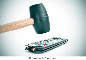 broking a remote control with a hammer - someone broking a...
