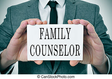 family counselor - a man wearing a suit sitting in a desk...