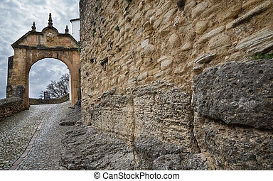The Felipe V Arch to the Old Bridge in Ronda, Andalusia,...