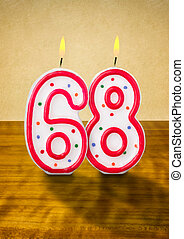 Burning birthday candles number 68