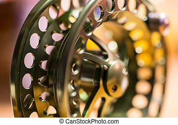 Fly reel - Abstract fly reel with colorful background