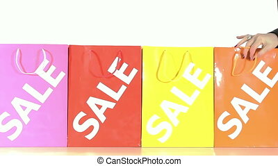 sale rush - women hands taking shopping bag before sales run...