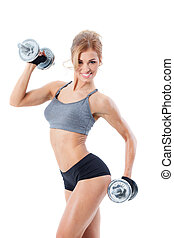 Fitness with dumbbells - Smiling athletic woman pumping up...