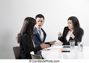 Angry Chinese business man shouting at his colleague in a business meeting