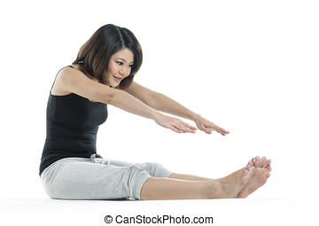 Beautiful Chinese woman stretching before exercise -...