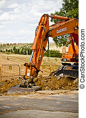 Construction site with excavating equipment - Construction...