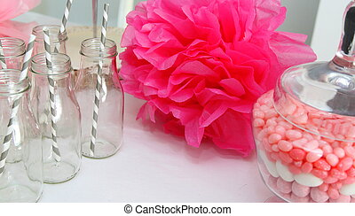 Baby shower decorations - Pompoms, glass bottles and candies...