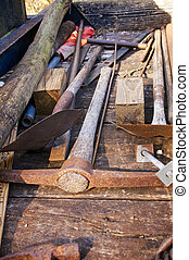 digging tools - A collection of digging tools on a plywood...