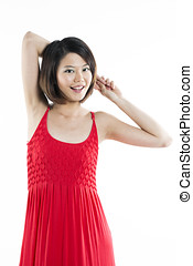 Happy Chinese woman wearing red summer dress Energetic...
