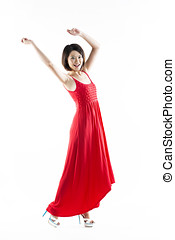 Happy Chinese woman wearing red summer dress Energetic full...