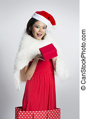 Happy woman wearing a Christmas hat - Happy Chinese girl...