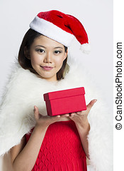 Happy woman wearing a Christmas hat - Beautiful Chinese...