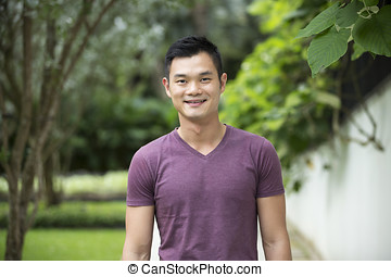 Chinese man standing outside - Portrait of a handsome...