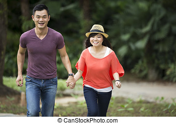 Young Chinese Couple having fun in park
