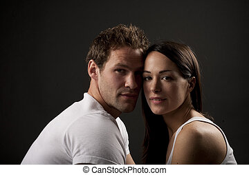 sexy couple - two lovers over dark background