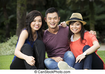 Happy Chinese friends hanging out - Group of Happy Chinese...
