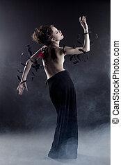 Slim topless model posing as fallen angel - Image of slim...
