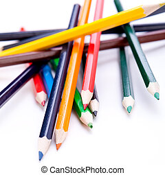 Bunch of colourful pencil crayons on white - Bunch of...