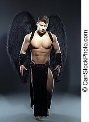Handsome muscular guy posing as fallen angel - Image of...