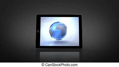 Earth montage displayed on digital tablet screen on black...