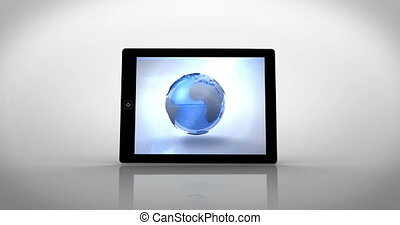 Earth montage displayed on tablet pc on white background