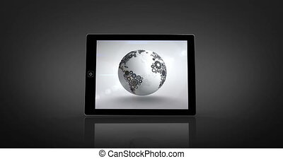 Earth made of cogs and wheels montage displayed on tablet...
