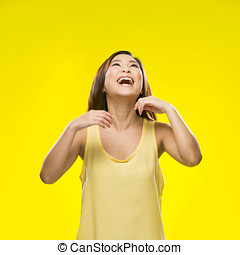 Young happy Chinese female model on colorful background -...