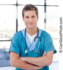 Happy Male Doctor - Happy male Doctor standing and smiling