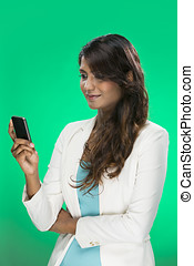Stylish Indian Woman using a smart phone Young and fresh...