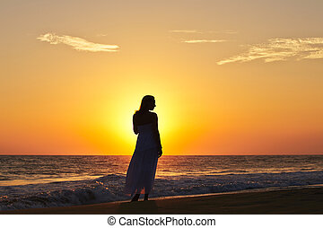 Woman on the beach - Pretty woman at sunset on the beach.