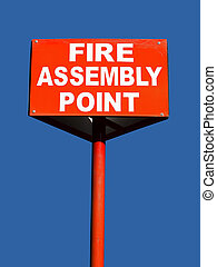 fire assembly point - close up of a fire assembly point sign