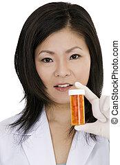 Doctor - Asian doctor holding a bottle of pills