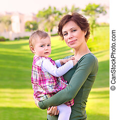 Baby girl with mom in the park
