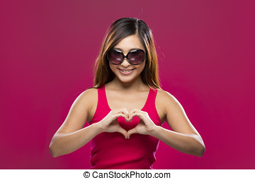Chinese Woman making heart symbol with her hands. - Portrait...