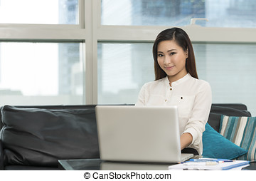 Young Asian business woman working from home - Young Chinese...