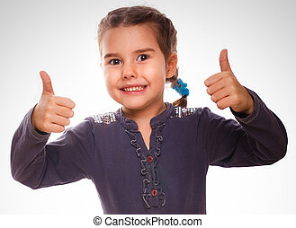 girl baby raised her thumbs up isolated smiling symbol indicates yes emotions gray