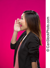 Chinese Woman shouting on bright pink background - Portrait...
